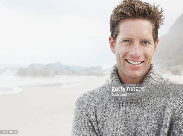 Mid adult man on beach, portrait, smiling