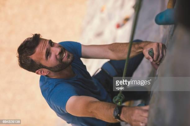 Mid adult man on free climbing