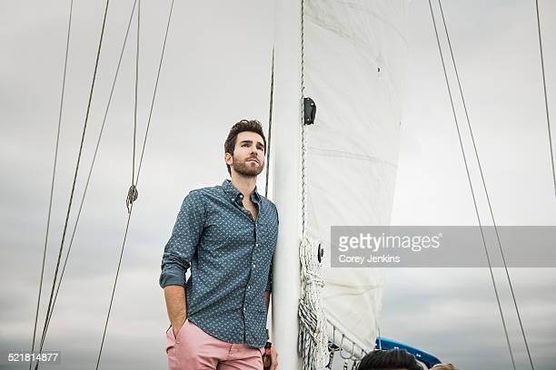 Mid adult man on sailing boat