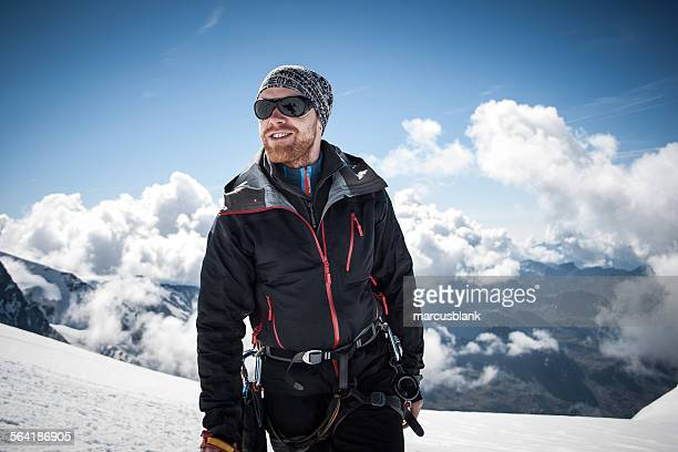 Mid adult man on the summit of Breithornsattel, Zermatt, Switzerland