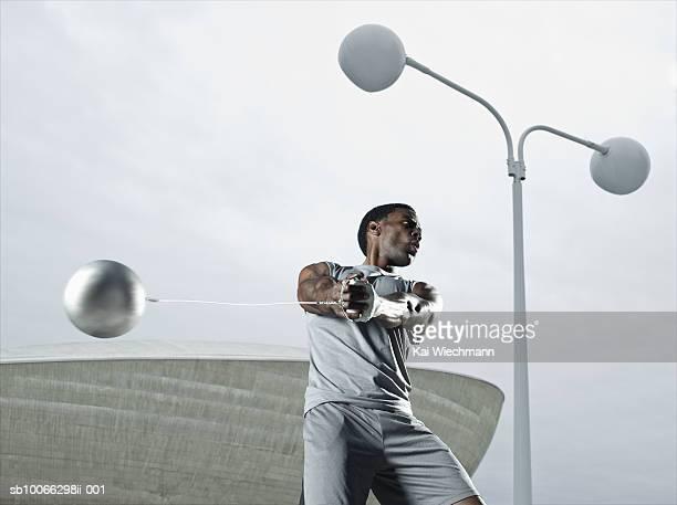 Mid adult man preparing to throw hammer