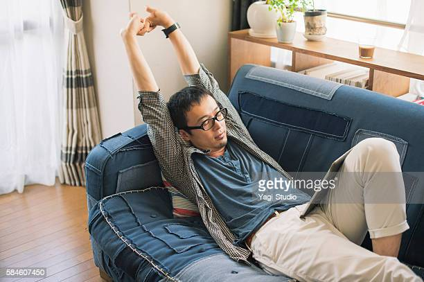 Mid adult man relaxing at home on holiday