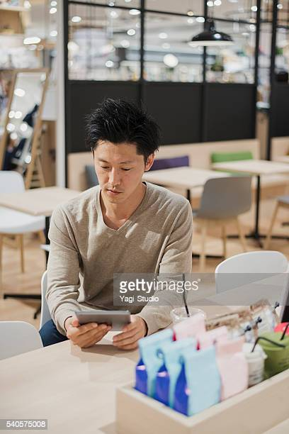 Mid adult man relaxing in a cafe.
