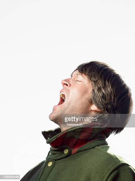 Mid adult man shouting