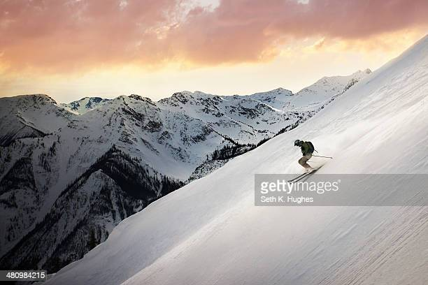 Mid adult man skiing down mountain, Golden, British Columbia, Canada