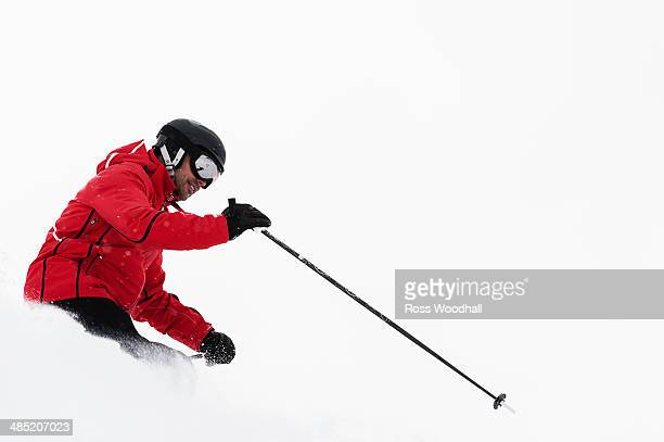 Mid adult man skiing, Obergurgl, Austria