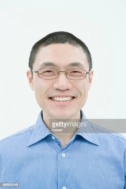 Mid adult man smiling, portrait