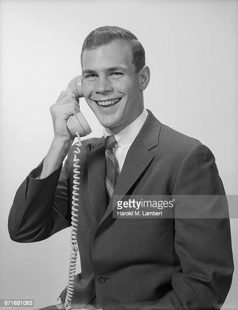 Mid Adult Man Talking On Telephone