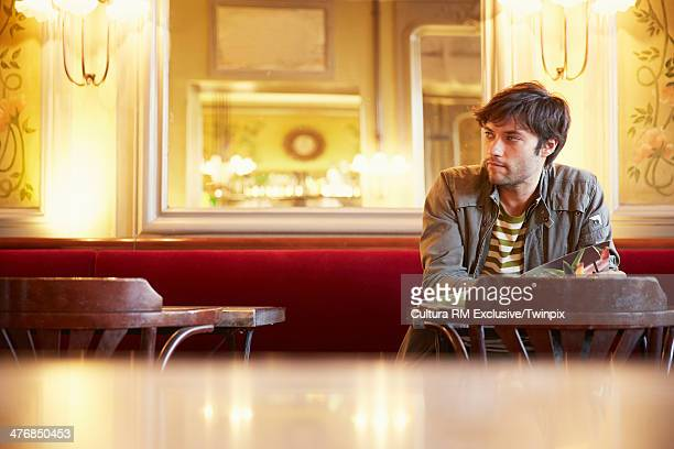 Mid adult man waiting in cafe bar