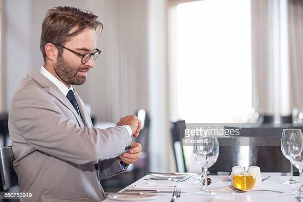 Mid adult man waiting in restaurant