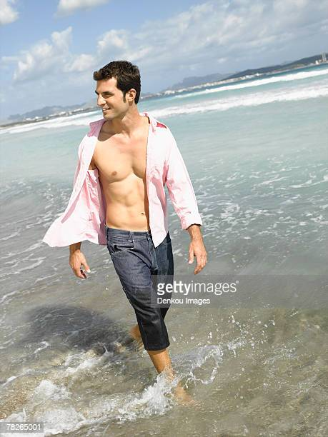 Mid adult man walking on the beach