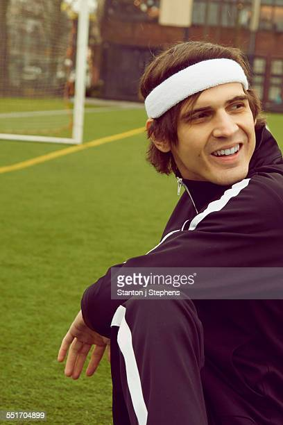 Mid adult man warming up on soccer pitch