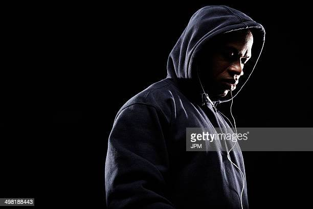 mid adult man wearing hooded top - gang stock pictures, royalty-free photos & images