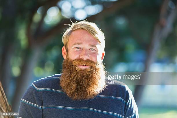 mid adult man with a long beard - beard stock pictures, royalty-free photos & images