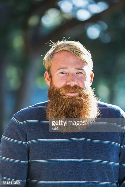Mid adult man with a long beard