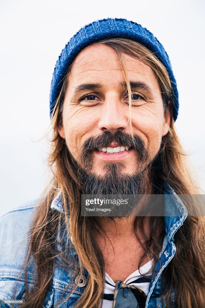 Mid Adult Man With Beard Wearing Hat Portrait Stock Photo  c1d84085d2a6