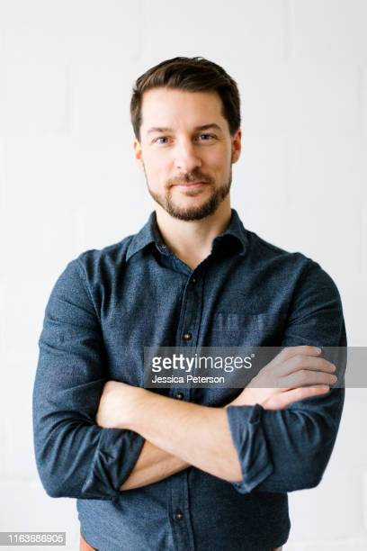 mid adult man with his arms crossed - camicia foto e immagini stock