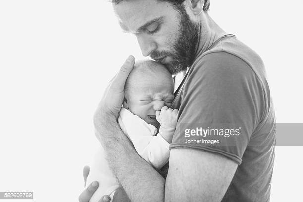 Mid adult man with newborn baby