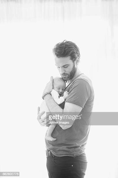 Mid adult man with newborn baby