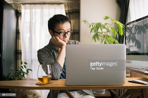 Mid adult man working at home on holiday