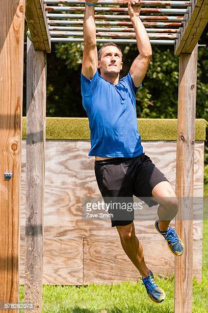Mid adult man, working out, outdoors
