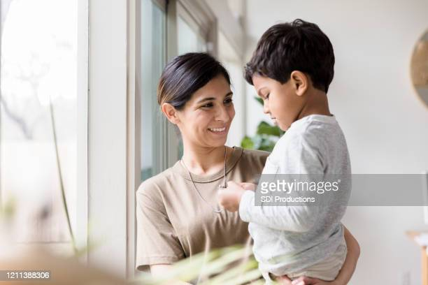 mid adult mom enjoys time with son - military stock pictures, royalty-free photos & images