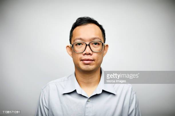 mid adult professional wearing eyeglasses - nerd stock pictures, royalty-free photos & images