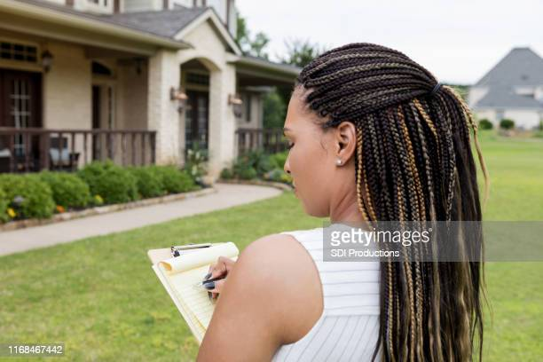 mid adult realtor evaluates a property for sale - inspector stock pictures, royalty-free photos & images