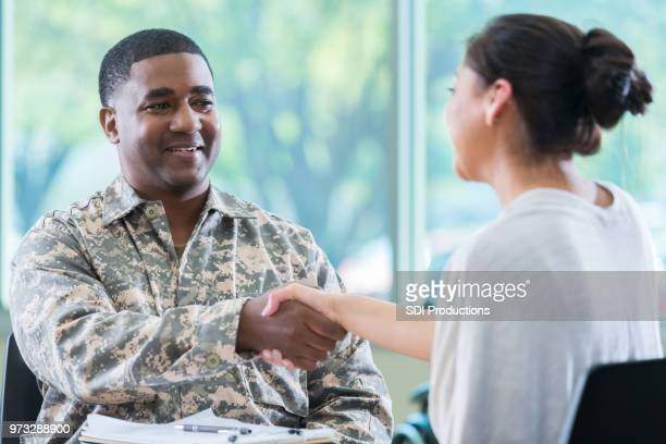 mid adult solder greets mental health professional - army training stock pictures, royalty-free photos & images