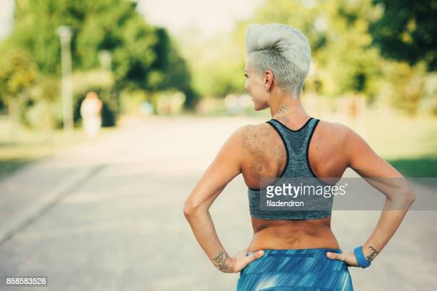 mid adult sportswoman - sports bra stock pictures, royalty-free photos & images