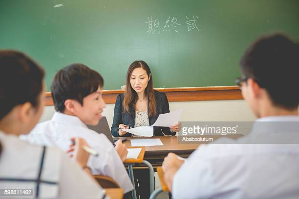 Mid Adult Teacher and Students, Hong Kong School, China,Asia