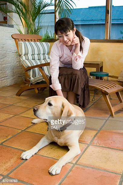 Mid Adult Woman and a Dog