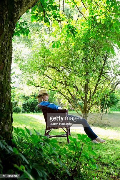 Mid adult woman asleep in garden chair