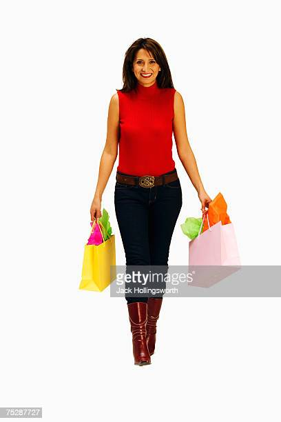 Mid adult woman carrying shopping bags