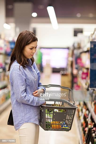 Mid adult woman choosing groceries in a supermarket