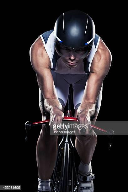 Mid adult woman cycling, studio shot