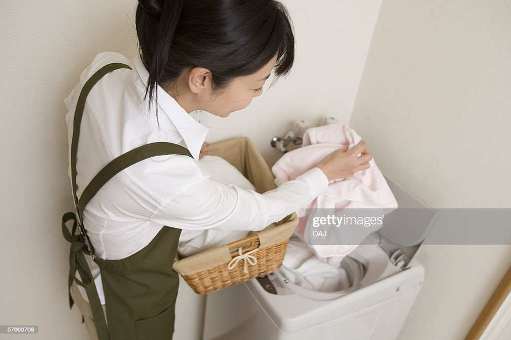 Mid Adult Woman do the laundry : Stock Photo
