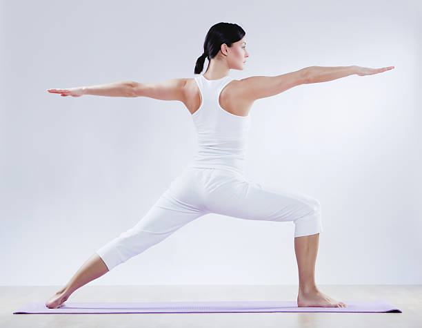 Mid Adult Woman Doing Yoga Against White Background Wall Art