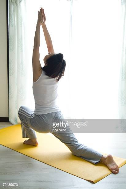 A mid adult woman doing yoga