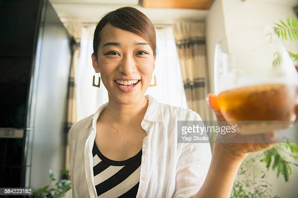 mid adult woman drinking beer at home - one mid adult woman only stock pictures, royalty-free photos & images