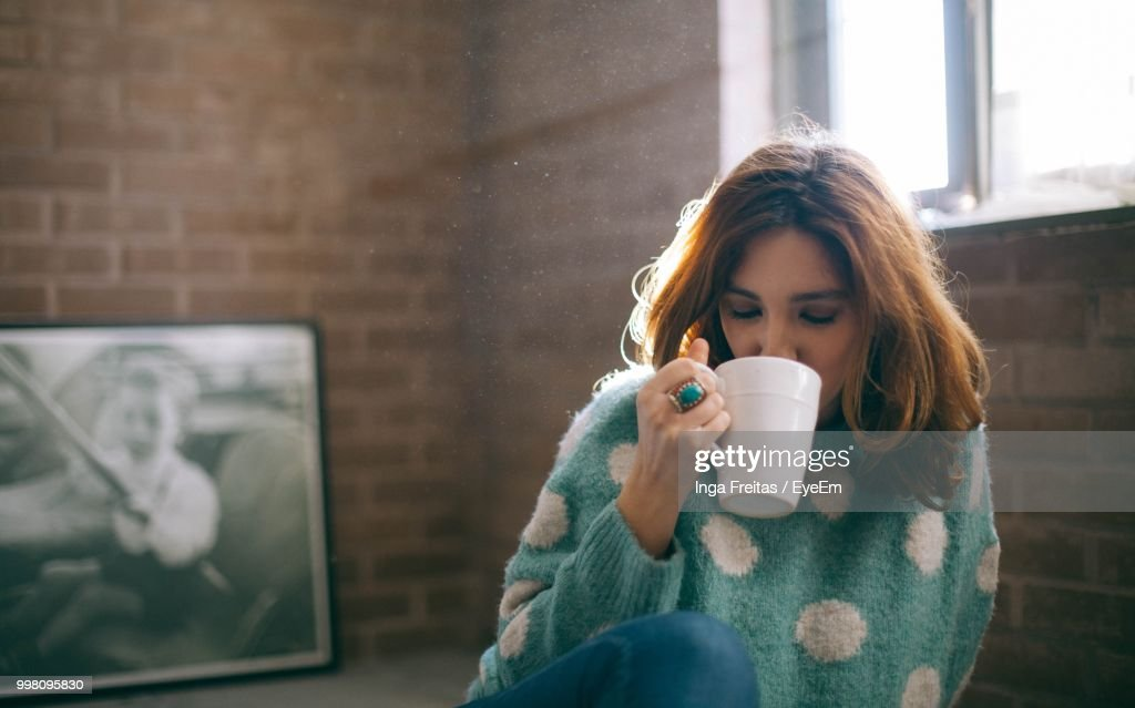 Mid Adult Woman Drinking Coffee At Home : Stock Photo