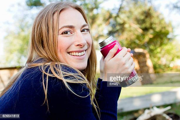 Mid adult woman drinking hot drink