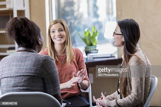 Mid adult woman during group therapy session