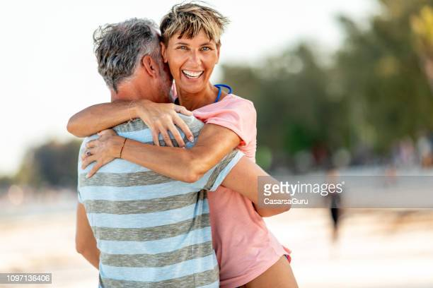 mid adult woman enjoying on tropical vacations with her partner - sugar daddy stock photos and pictures