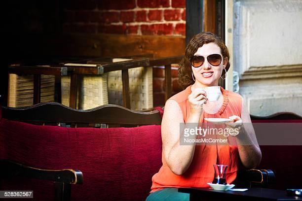 Mid Adult woman enjoying Turkish coffee in Istanbul