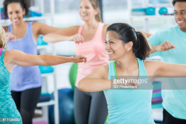 mid adult woman enjoys aerobics class - dance studio stock pictures, royalty-free photos & images
