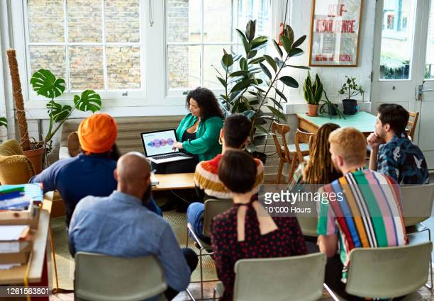 mid adult woman giving presentation using laptop - new business stock pictures, royalty-free photos & images