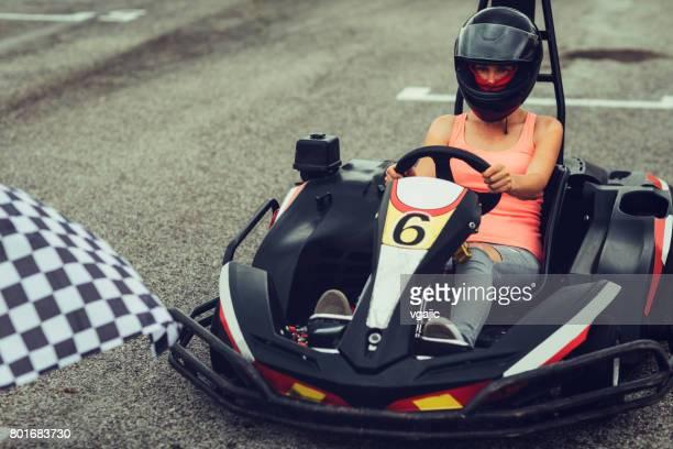 Mid adult woman go-Karts.