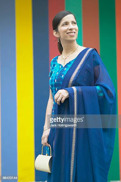 mid adult woman holding a purse - salwar kameez stock photos and pictures