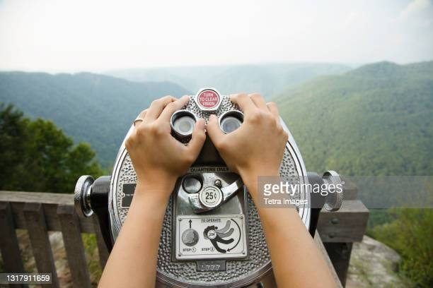 mid adult woman holding coin operated binoculars,  focus on hands, new river gorge national river, fayetteville, west virginia, usa - fayetteville stock pictures, royalty-free photos & images